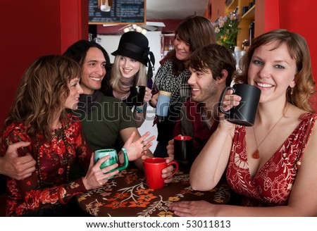 Group of six friends engaged in a social activity - stock photo