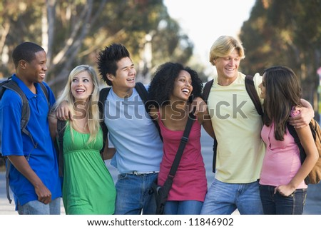 Group of six friends having fun outside - stock photo