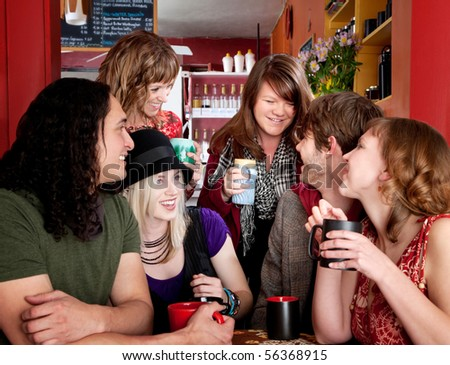 Group of six happy friends at a cafe - stock photo