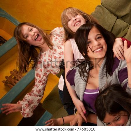Group of six little girls enjoying their leisure - stock photo