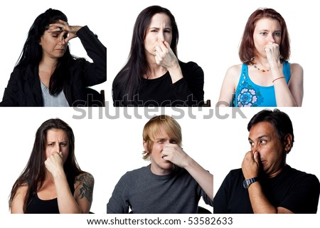 Group of six people holding their noses - bad smells in the air - stock photo
