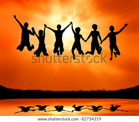 group of six teen friends jumping with joy and freedom at sunrise silhouetted - stock photo