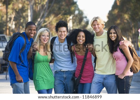 Group of six young firneds having fun outside - stock photo