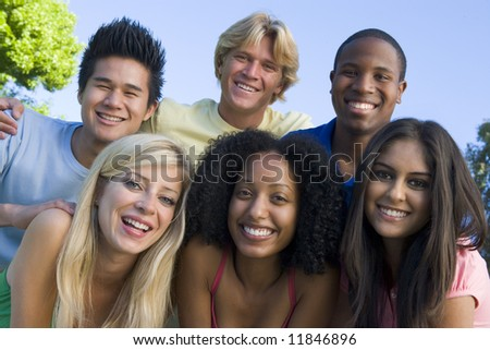 Group of six young friends having fun outside - stock photo