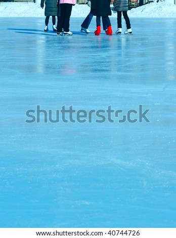 Group of skaters on blue ice - stock photo