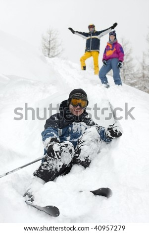 Group of skiers in the deep snow - stock photo