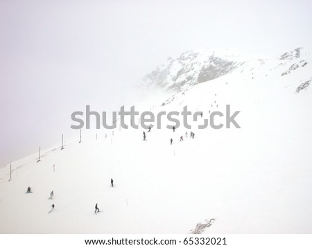 Group of skiers on the mountain slope.