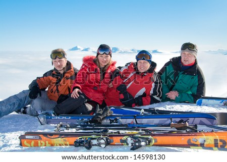 Group of skiers on the top of Stig mountain. On background Goverla is highest mountain of Ukraine. - stock photo