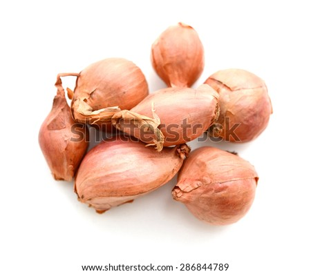 Group of small red shallot onions isolated on white