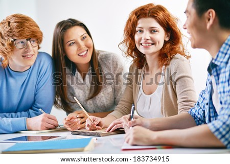Group of smart groupmates sitting at lesson