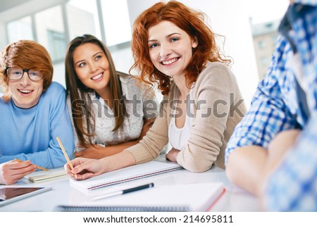 Group of smart groupmates sitting at lesson - stock photo