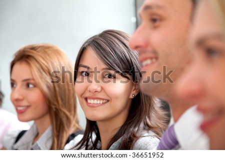 Group of smiley business people lined up - stock photo