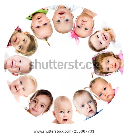 Group of smiling babies standing in huddle on white background