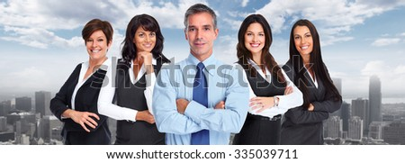 Group of smiling business people over urban background - stock photo