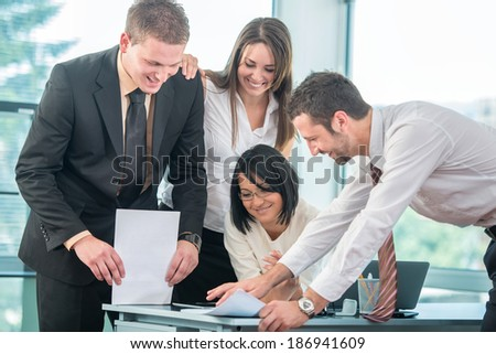 Group of smiling business people working in office