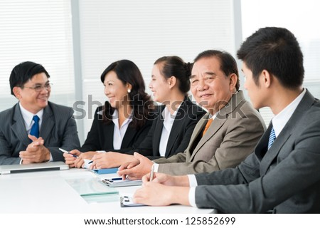 Group of smiling businessmen - stock photo