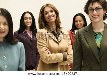 Group of smiling businesswomen - stock photo