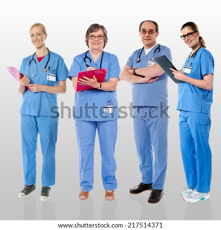 Group of smiling doctors, full length portrait - stock photo