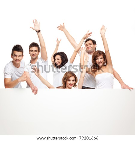 group of smiling friends excited over a white banner