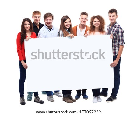 group of smiling friends holding blank banner  - stock photo