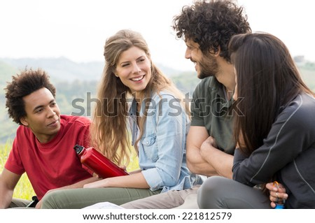 Group Of Smiling Hiker Sitting Together Outdoor - stock photo