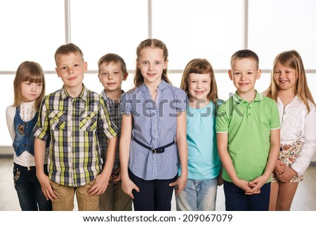 Group of smiling kids standing together - stock photo