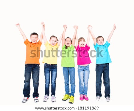 Group of smiling kids with raised hands in colorful t-shirts standing together - isolated on white. - stock photo
