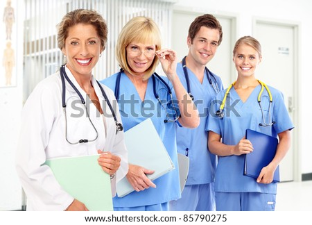 Group of smiling medical doctors. Health care. - stock photo