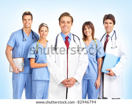 Group of smiling medical doctors. Over blue background. - stock photo