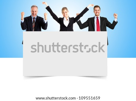 Group of smiling people showing a blank board - stock photo