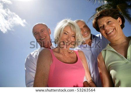 Group of smiling senior men and women