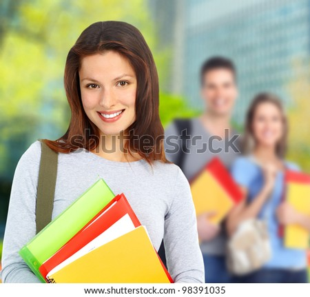 Group of smiling  students and girl with book. University education. - stock photo
