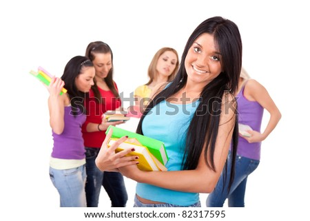 group of smiling students , portrait of smart student girl with the classmates on the background- isolated - stock photo