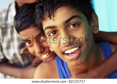 Group of Smiling teen boys looking at the camera.