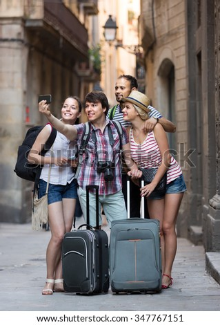 Group of smiling tourists making selfie on the background of landmark - stock photo