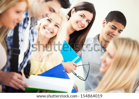 Group of smiling university students standing together. - stock photo