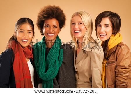 Group of smiling women wearing warm clothes. - stock photo