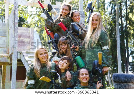 Group of smiling young girls with paintball ammunition - stock photo