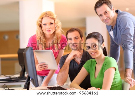Group of smiling young people in training course - stock photo
