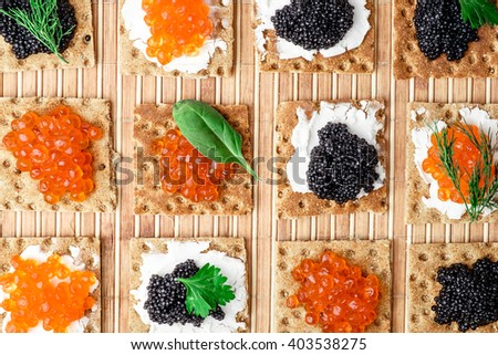 Group of snacks with red and black caviar - stock photo