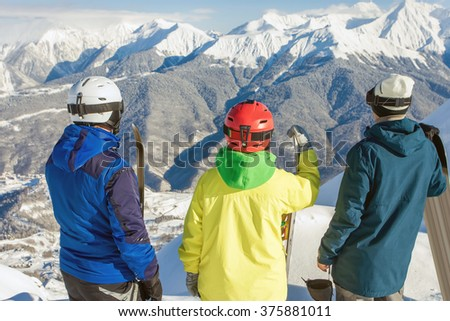 Group of snowboarders and skier at summit. Winter sports. Switzerland, alps. Snowboard. - stock photo