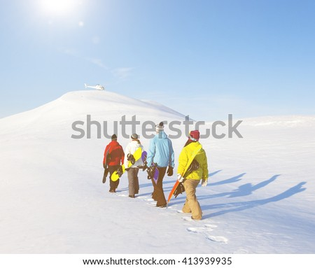 Group of snowboarders enjoying a beautiful Winter morning.