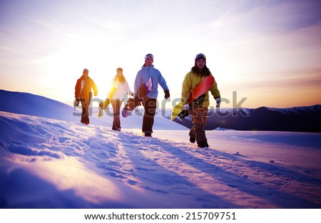 Group of snowboarders on top of the mountain. - stock photo