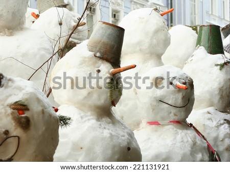 group of snowmen - stock photo