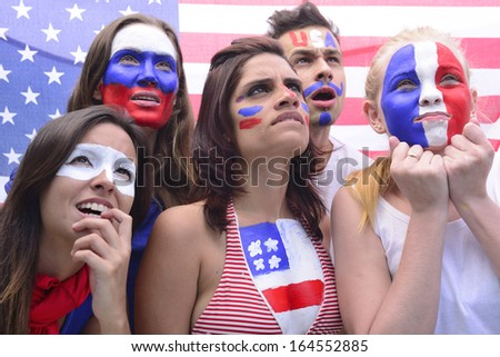Group of soccer fans concerned- - stock photo