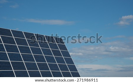 Group of Solar energy  panels creating electricity from the sun.  Solar panels are one of the best renewable energy sources helping saving the environment. - stock photo