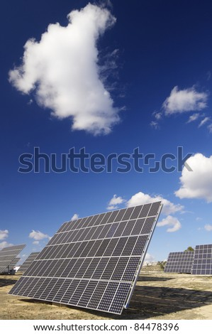 group of solar panels for production of renewable electrical energy - stock photo