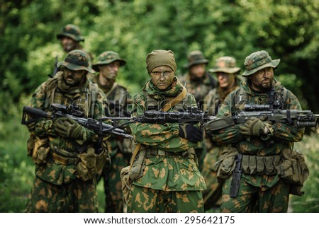 Group of soldiers Russian special forces during the raid in the forest