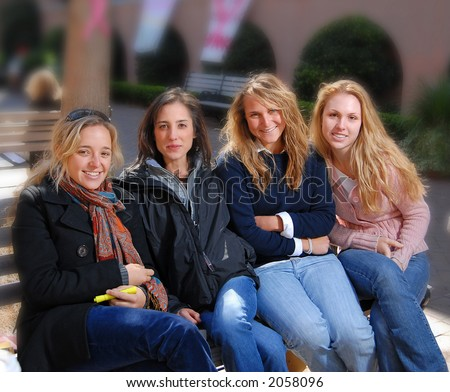 Group of sorority girls sitting on bench