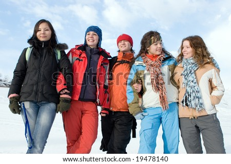 Group of sport teens different ethnicity winter outdors at mountain Tien Shan. One boy and four girls